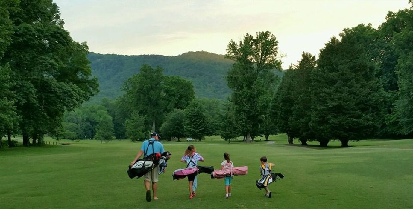 Family playing golf